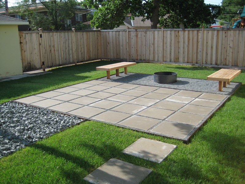 Contemporary paver patio in a clean lined yard