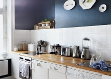 Cool bluish-gray on wall transforms this tiny kitchen [From: Brita Sönnichsen Photogrphy]