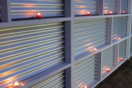 Corrugated metal fence with candles privacy fence Modern Privacy Fence Ideas for Your Outdoor Space Corrugated metal fence with candles 270x180