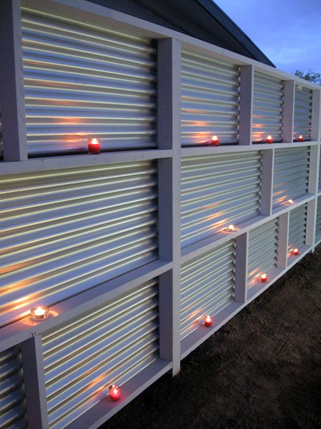 Corrugated metal fence with candles