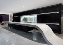 Custom-concrete-kitchen-island-with-a-black-backdrop-217x155