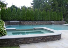 Cypress trees provide privacy to a pool area
