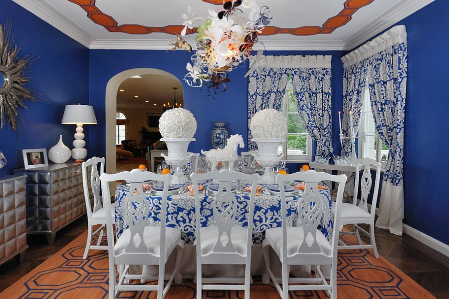 Eclectic dining room with blue and orange [Design: Kenneth Davis Lux International]