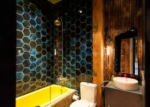 Eclectic industrial bathroom with plenty of color and pattern