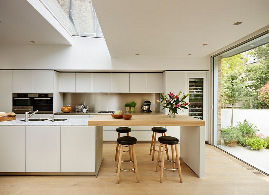 Elegant kitchen in white with a skylight [Design: bulthaup by Kitchen Architecture]