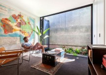 Foldable glass doors connect the interior with the outdoors