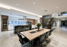 Formal dining space with wooden table and dark chairs