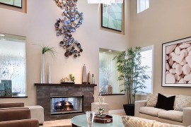 Giant metallic wall art installation in the high ceiling living room [Design: International Custom Designs]