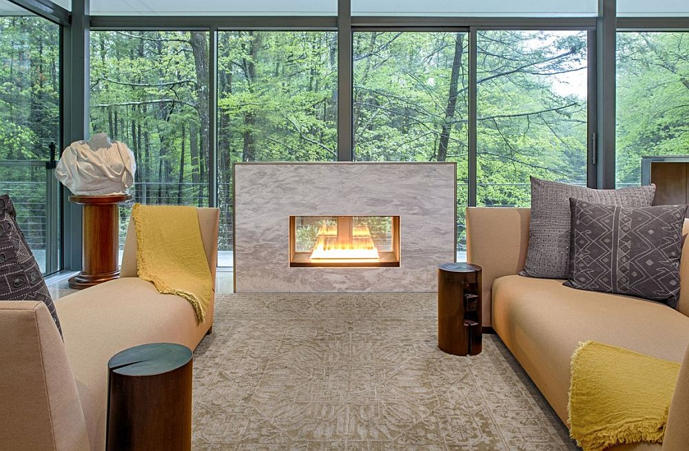 Glass walls bring the forest canopy indoors
