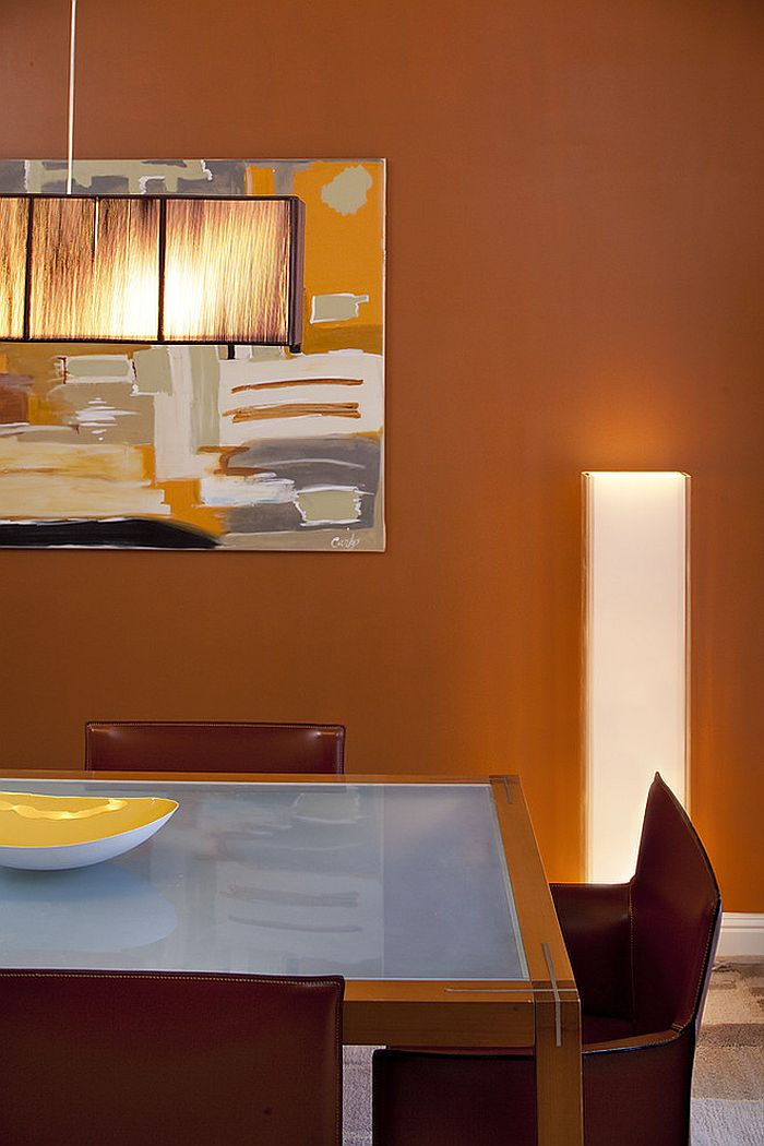 Gorgeous dining room draped in orange goodness [Design: Mark Newman Design]