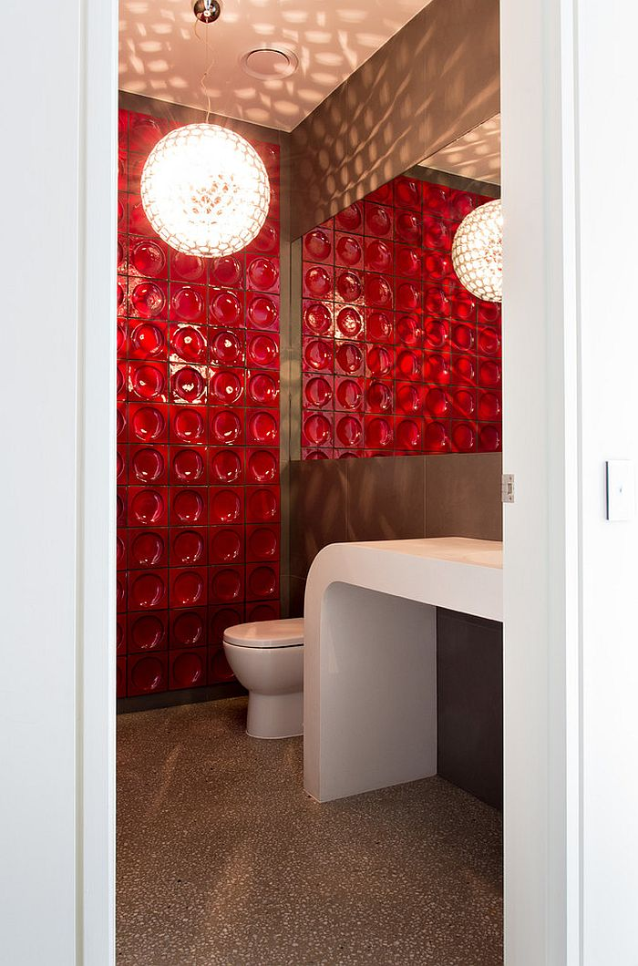 Gorgeous red tile steals the show in the small powder room