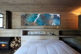 Gorgeous wall art adds color to the contemporary bedroom