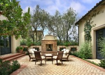 Herringbone patio near an outdoor fireplace