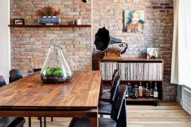 Industrial elements shape the renovated dining space with brick walls