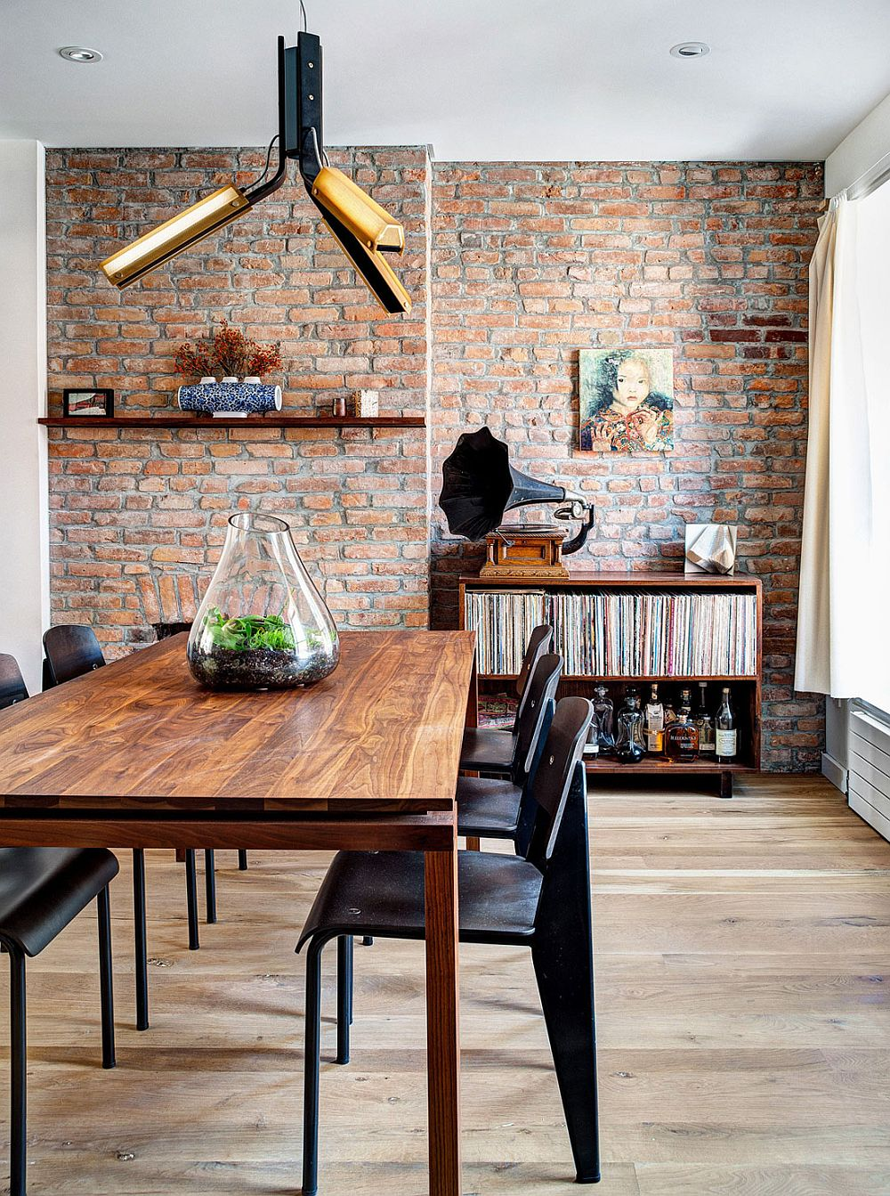 Industrail elements shape the renovated dining space with brick walls