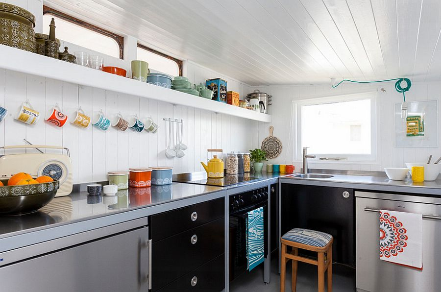 Ingenious use of kitchenware to bring color to the Scandinavian kitchen [From: Chris Snook Photography]
