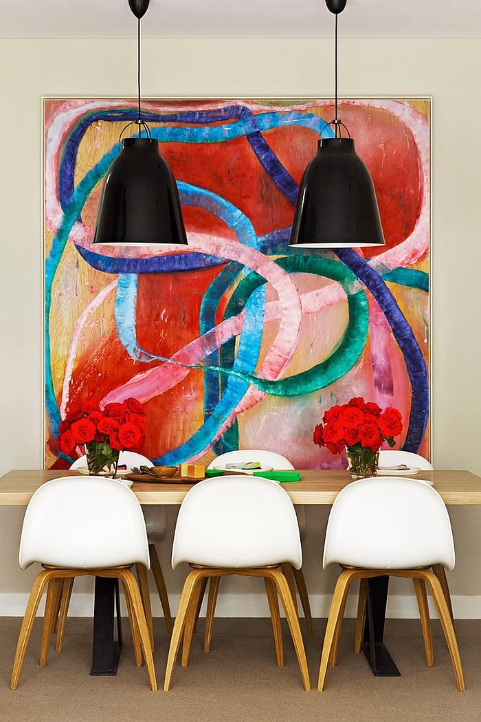 It is the art piece that sets the mood in this dining room