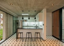 Kitchen area in concrete of the elegant becah house