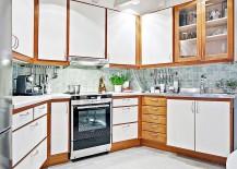 Kitchen-of-attic-apartment-in-Gothenburg-with-a-hexagonal-design-217x155