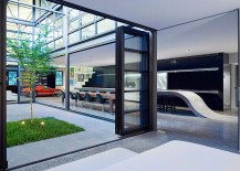 Large-glass-doors-and-windows-create-seamless-interface-between-interior-and-courtyard-217x155