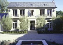 Large stucco home with a shingled roof