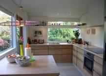 Large-windows-bring-the-landscape-outside-indoors-217x155