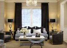 Light color scheme of the living room complements the dark drapes perfectly