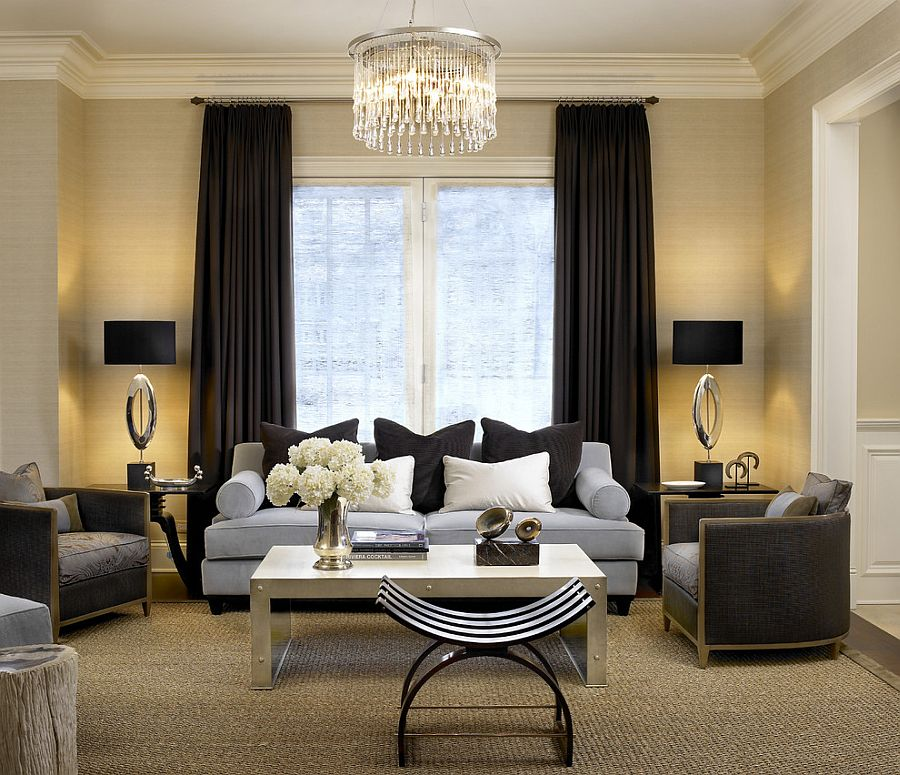 Light color scheme of the living room complements the dark drapes perfectly [Design: Handman Associates]