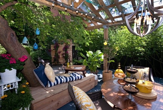 Loungey tree bench on a beautiful patio  Tree Bench Ideas for Added Outdoor Seating Loungey tree bench on a beautiful patio