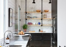 Lovely use of black inside the narrow Scandinavian kitchen