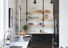 Lovely-use-of-black-inside-the-narrow-Scandinavian-kitchen-217x155