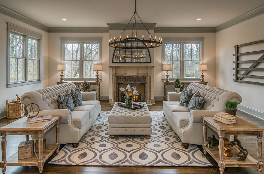 Elegant use of ottoman-styled coffee table in the classy living room [Design: Millworks Designs]