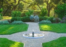 Lush green yard with a fountain at the center