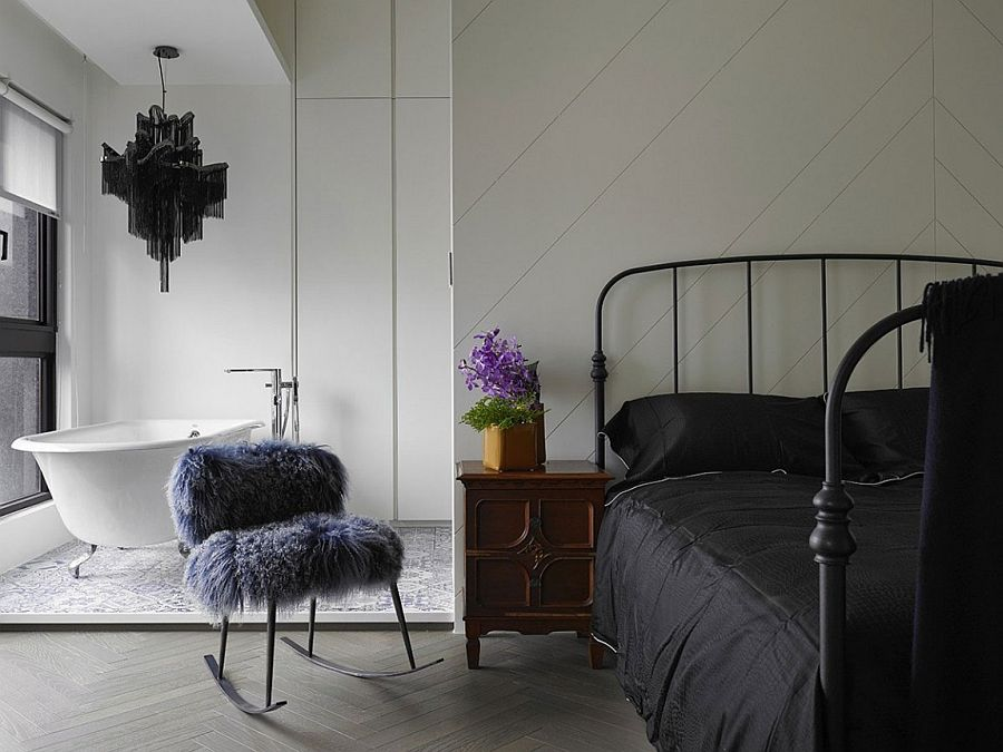 Master bedroom design with standalone bathtub in the corner