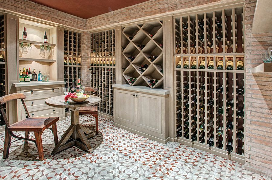 Mediterranean style wine cellar with beautiful lighting and floor [Design: Meridith Baer Home]