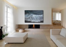 Minimal living room with wall art inspired by nature hanging above the fireplace [From: John Wolf Fine Art]