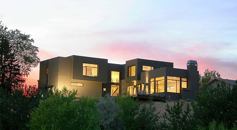 Modern stucco home with a boxy structure