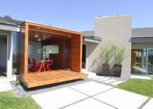 Modern stucco home with a manicured yard