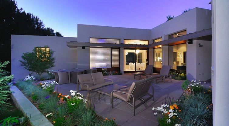 Modern stucco home with a patio