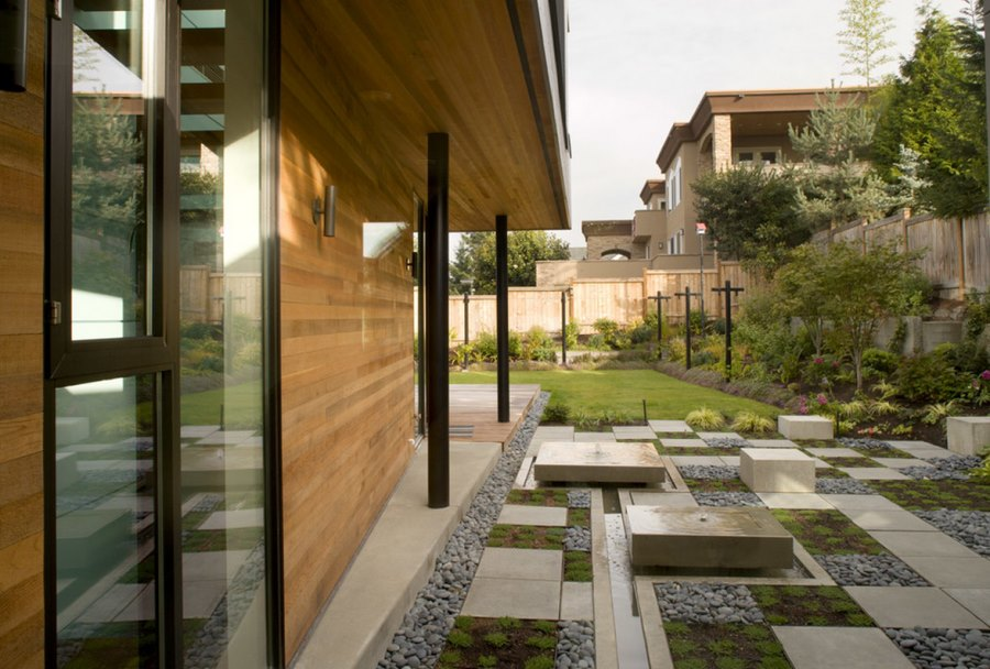 View in gallery Modern yard with squares of concrete, gravel and plants