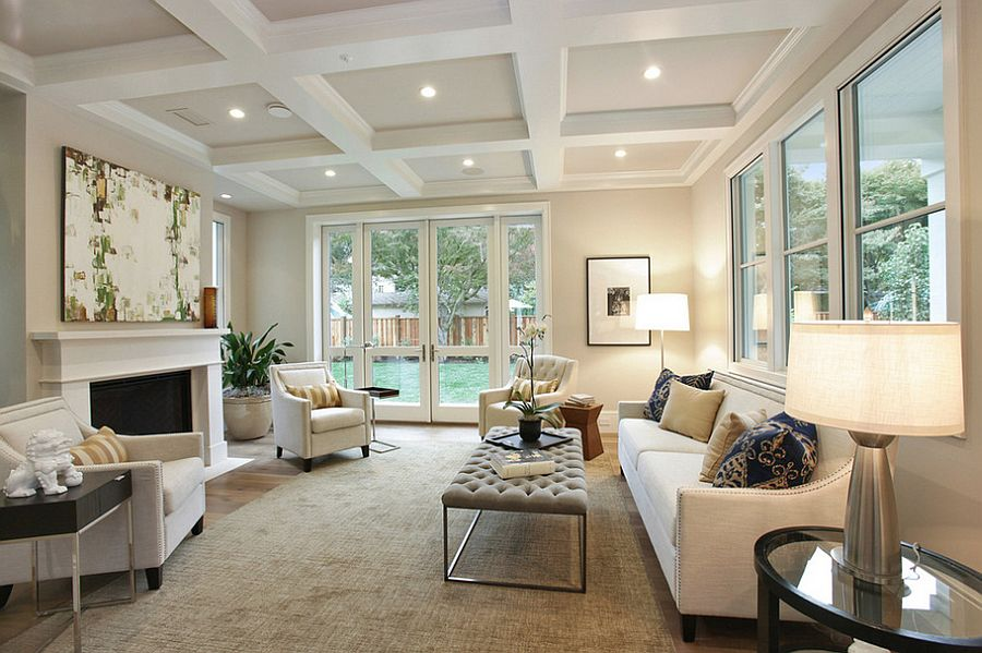 Monochromatic living room with a tufted coffee table [Design: Clarum Homes]