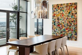 Neutral color scheme of the dining room allows the wall art to make a big impact [Design: Maven Interiors]
