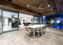 Outdoor-dining-area-of-the-Perth-home-with-a-view-of-the-pool-217x155
