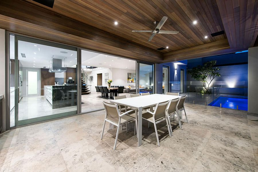 Outdoor dining area of the Perth home with a view of the pool