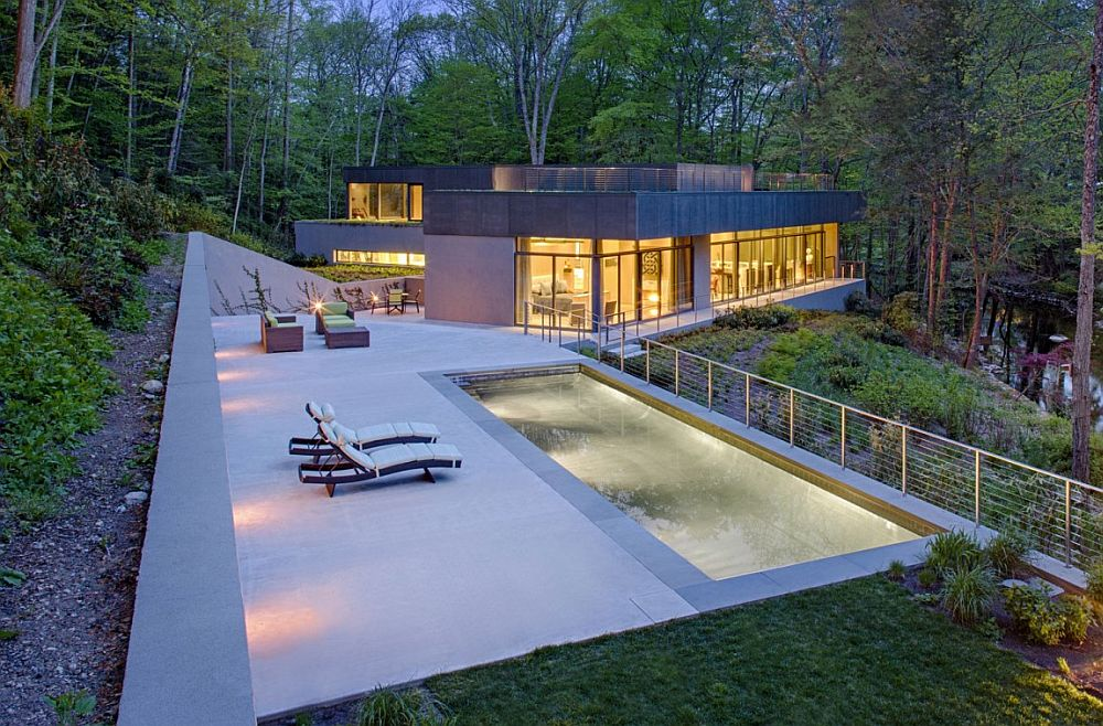 Outdoor retreat with pool adds to the appeal of the lakeside home