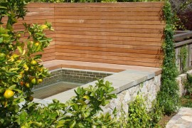 Privacy fence surrounding a custom-built spa privacy fence Modern Privacy Fence Ideas for Your Outdoor Space Privacy fence surrounding a custom built spa 270x180