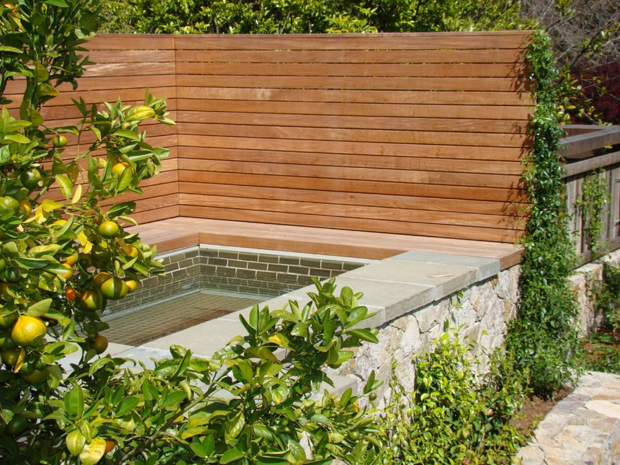 Privacy fence surrounding a custom-built spa