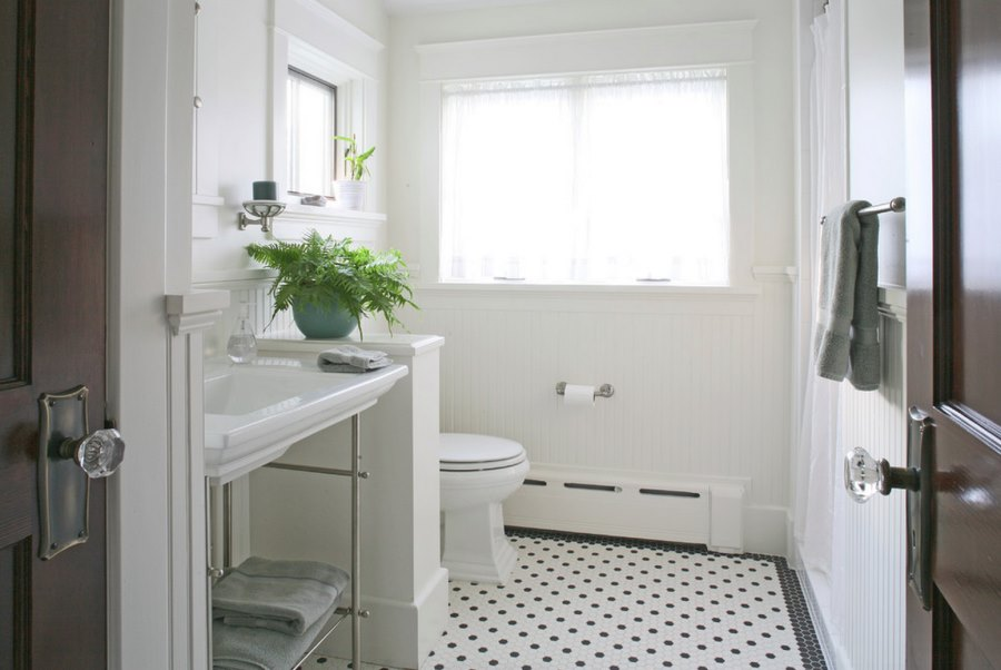 Refreshing white bathroom with beadboard paneling