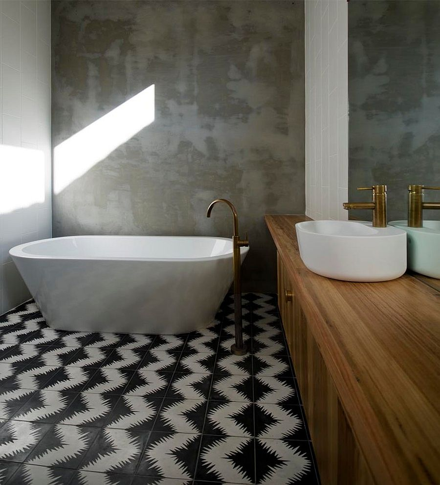 25 creative geometric tile ideas that bring excitement to your home rendered concrete walls of the bathroom stand in contrast to the geometric cement tiles design dailygadgetfo Gallery