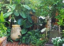 Running-bond-brick-pattern-for-a-plant-filled-patio-217x155